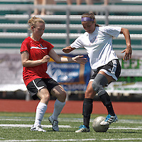 CFC Passion midfielder Kerry Scalora (16) dribbles as Aztec MA defender Dana Bergstrom (21) defends. In a Women's Premier Soccer League (WPSL) match, Aztec MA defeated CFC Passion, 4-0, at North Reading High School Stadium on July 1, 2012.