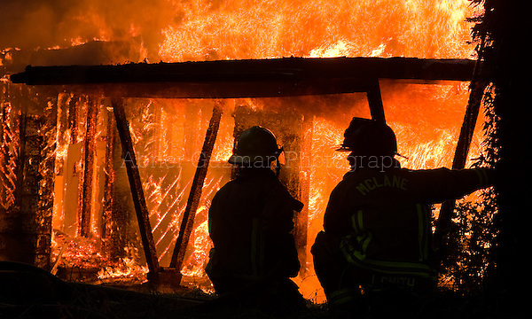 Firefighters from the McLane-Black Lake Fire Department train along Delphi Road May 30 in Olympia.
