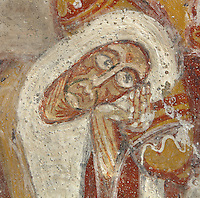 Detail of Virgin Mary face lying next to Joseph in the Nativity scene, 12th century frescoes in the choir of the Pre-Romanesque Chapel of Saint Martin de Fenollar (Sant Marti de Fenollar), 9th century, Maureillas Les Illas, Pyrenees Orientales, France. The frescoes are an outstanding piece of work, which greatly impressed modern artists, especially Pablo Picasso and Georges Braque in 1910. Picture by Manuel Cohen
