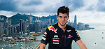 Red Bull Toro Rosso driver Jaime Alguersuari poses on the roof of the Harbour Grand Hong Kong Hotel before participating in the Red Bull Dragon Run 2011 in Hong Kong, China.