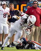 HAWGS ILLUSTRATED JASON IVESTER --08/30/2014--<br /> Arkansas junior wide receiver Keon Hatcher maintains his balance after a tackle attempt from Auburn senior defensive back Trovon Reed on Saturday, Aug. 30, 2014, against Auburn at Jordan-Hare Stadium in Auburn, Ala.