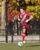 Boston College defender Matt Wendelken (8) brings the ball forward. Boston College (maroon) defeated Virginia Tech (Virginia Polytechnic Institute and State University) (white), 3-1, at Newton Campus Field, on November 3, 2013.
