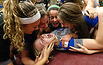 Pleasant Grove junior Madison Wolford, center, celebrates with the rest of her teammates after the Vikings won their Utah State High School Volleyball 5A championship match against Lone Peak in the UCCU in Orem, Saturday, Nov. 3, 2012.