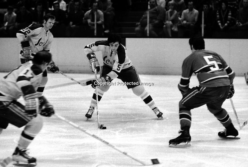 California Golden Seals Carol Vadnais, Dennis Hextal, and Norm Gerguson, Montreal Canadiens Guy Lapointe. (1971 photo by Ron Riesterer)