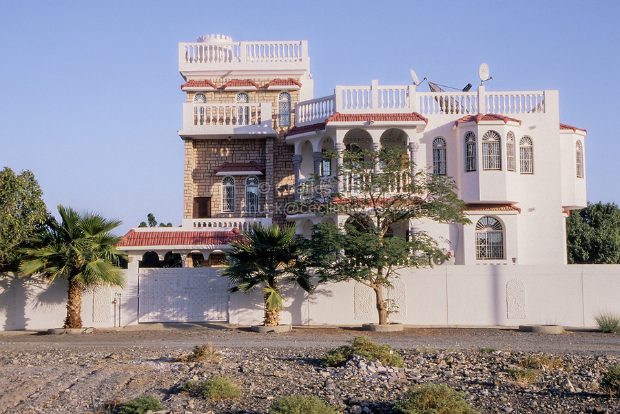 Bahla, Oman.  New Upper-middle-class House, with three satellite dishes.