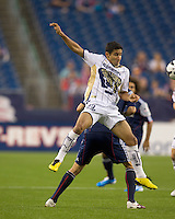 Pumas UNAM defender Luis Fuentes (33) battles for the ball. The New England Revolution defeated Pumas UNAM in SuperLiga group play, 1-0, at Gillette Stadium on July 14, 2010.