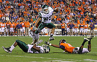 Oct 23, 2010; Charlottesville, VA, USA;  Eastern Michigan Eagles wide receiver Chaz Mitchell (29) leaps over teammate Eastern Michigan Eagles running back Dwayne Priest (22) and Virginia Cavaliers safety Rodney McLeod (4) while being chased by Virginia Cavaliers defensive end Jake Snyder (90) during the 1st half of the game at Scott Stadium.  Mandatory Credit: Andrew Shurtleff