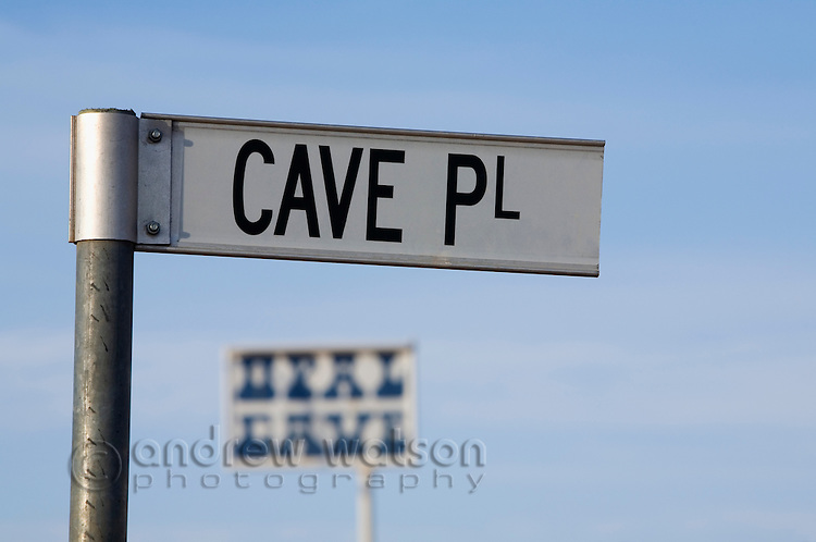 Street sign for Cave Place - in the opal mining town of Coober Pedy.  Due to the extreme climate half the town's population live in dugouts (underground rooms). Cooper Pedy, South Australia, AUSTRALIA.