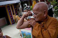 Buddhist monk Thich Hue Tien, 73, shows off his arm muscle at the Giac Vien Pagoda in District 11 in Ho Chi Minh City, Vietnam. Photo taken Monday, May 3, 2010...Kevin German / LUCEO