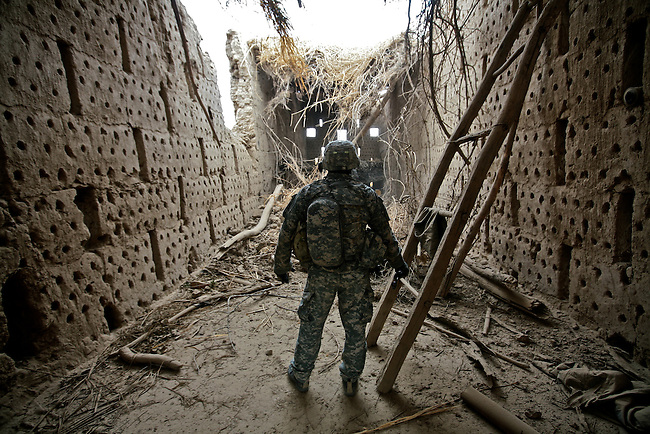 Sgt. Sal Prieto, 26, of Kenosha, Wis., checks out a damaged grape-drying hut after it was hit by a Hellfire missile near the village of Ashoque in Zhari district, Kandahar province, Afghanistan. Soldiers with Company B, 1st Battalion, 12th Infantry Regiment called in an air strike on the structure after their nearby outpost came under attack. They believed Taliban fighters were firing from the spot, but found nothing to indicate that the fighters had ever been there. Dec. 3, 2009. DREW BROWN/STARS AND STRIPES