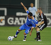 El Salvador National Team midfielder Eliseo Quintanilla (10) gets pull back from behind by DC United midfielder Kurt Morsink (9).  DC United defeated El Salvador National Team 1-0 in a international charity match at RFK Stadium, Saturday June 19, 2010.