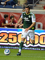 Portland forward Kenny Cooper (33) dribbles the ball.  The Portland Timbers defeated the Chicago Fire 1-0 at Toyota Park in Bridgeview, IL on July 16, 2011.