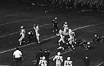 """Bethel Park PA:  Offensive play with Mike Stewart 11 throwing the ball away.  The offensive line was unanimous in yelling """"look out"""" on this play!  Others in the photo; Clark Miller 30, Don Troup 51, Glenn Eisaman 71, Joe Barrett 75. Uniontown was coached by long-term Upper St Clair Coach Jim Render and big time college and pro running back Chuck Muncie.  The offense and defense played well enough to win 21-14.  This was the most points given by the defense all year.  The defensive unit was one of the best in Bethel Park history only allowing a little over 7 points a game."""