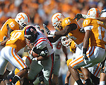Ole Miss running back Enrique Davis (27) runs past Tennessee defensive back Marsalis Teague (10) and Tennessee defensive end Chris Walker (84) in a college football game at Neyland Stadium in Knoxville, Tenn. on Saturday, November 13, 2010. Tennessee won 52-14.