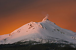 Steam venting from the top of snow covered Nuevo Mundo Volcano at sunset, Potosi, Bolivia