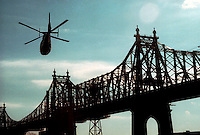 A helicopter flies past the Ed Koch-Queensboro Bridge in Manhattan in this file photo. The Dept. of Homeland Security has tightened security around helicopters in New York City because of intelligence received that Al Qaeda might be planning to use the aircraft as flying bombs. (© Frances M. Roberts)