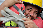 Oscar Oliva, a member of a Mexican search and rescue team, cries with joy on January 19, 2010, as he embraces a fellow rescuer after the group pulled 70-year old Ena Zizi from the rubble of Haiti's devastating earthquake, exactly one week after the city was reduced to ruins in a matter of seconds. Zizi was rescued from the collapsed home of the parish priest at Port-au-Prince's Roman Cathedral Cathedral of Our Lady of the Assumption. Oliva is a firefighter from the Mexican city of Quintana Roo.