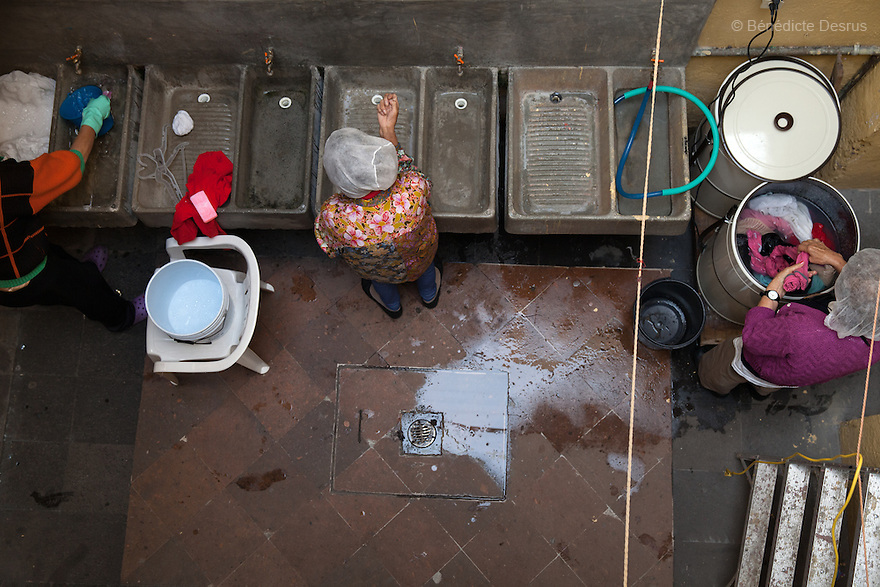 Three residents of Casa Xochiquetzal wash their clothes at the shelter in Mexico City, Mexico on September 3, 2013. Casa Xochiquetzal is a shelter for elderly sex workers in Mexico City. It gives the women refuge, food, health services, a space to learn about their human rights and courses to help them rediscover their self-confidence and deal with traumatic aspects of their lives. Casa Xochiquetzal provides a space to age with dignity for a group of vulnerable women who are often invisible to society at large. It is the only such shelter existing in Latin America. Photo by Bénédicte Desrus