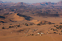 Namibia, Namib Desert, Damaraland, aerial view of small farming community in Huab River valley