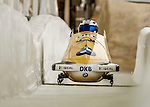 8 January 2016: Francesco Friedrich, piloting his 2-man bobsled for Germany, enters the Chicane straightaway on his second run, ending the day with a combined 2-run time of 1:51.44 and earning an 8th place finish at the BMW IBSF World Cup Championships at the Olympic Sports Track in Lake Placid, New York, USA. Mandatory Credit: Ed Wolfstein Photo *** RAW (NEF) Image File Available ***