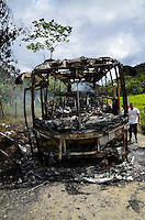 TUTUNENDO, COLOMBIA - DECEMBER 22, 2016: People stand next to a Bus attacked by members of the National Liberation Army (ELN) near Tutunendo Choco. local media said. Photo by VIEWpress/Guillermo Betancur