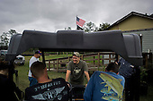 Jacksonville, Florida<br /> November 4, 2013<br /> <br /> Veteran's sustainable farm founded by Purple Heart veteran Adam Burke and managed by Afghan and Iraqi veteran Steve Ellseberry.<br /> <br /> Gaines Matheny (back to camera fish on shirt), Marine Trey Evans (far right), Steve Ellseberry (left white shirt), Marine Shaun Valdivia (center) share a story with Adam Burke (back to camera blue shirt). The farm provides excellent comradery between the vets and allows them to share combat stories with those who have been there.