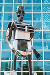 Garden City, New York, USA. June 14, 2015. TThe tall robot man metal sculpture, by artist C. Evan Gray, is on display outdoors in front of the glass facade of the Cradle of Aviation Museum, at Eternal Con, the Long Island Comic Con. The sculptor created it from automotive and other parts.