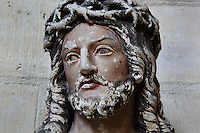 Ecce Homo, sculpture of Christ wearing the crown of thorns, in the Basilique Saint Remi or Abbey of St Remi, Reims, France. The 11th century, mainly Romanesque, church, contains the relics of St Remi, the Bishop of Reims, who converted Clovis, the King of the Franks, to Christianity in 496 AD. The abbey is a UNESCO World Heritage Site. Picture by Manuel Cohen