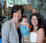 Garden City, New York, USA. 26th May 2015. L-R, RITA KESTENBAUM (D-Bellmore), running for Hempstead Town Supervisor, poses with her grandson JUSTIN KESTENBAUM, 14-months-old, and her daughter-in-law NATALIE KESTENBAUM, at the Nassau County Democrats nominating convention. The party's executive committee nominated 55 candidates, including R. Kestenbaum, for political and judicial races at the convention, held at the Cradle of Aviation in Garden City, Long Island.