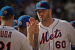 New York Mets relief pitcher Jon Rauch ( R) celebrates the end of the game with his teammates against Miami Marlins at Citi Field Stadium in New York. Photo by Eduardo Munoz Alvarez / VIEW.