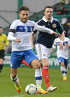 Italy U21 Ciro Immobile vies for the ball with Scotland U21 Daniel Wilson