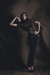 Black female model wearing black clothes posing for fashion shoot