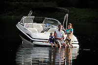 Family on Boat on Pactola Lake, Black Hills, near Rapid City, South Dakota, USA