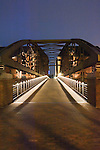 Lights on a continuous walkway over bridge. Speicherstadt old town. Customs houses, warehouse and dock areas of Hamburg, Germany.