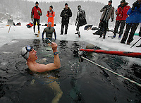 Stig  Severinsen from Denamark is happy after a dive at the freediving competition Oslo Ice Challenge, held at freshwater lake Lutvann outside the Norwegian capital Oslo. Atheletes, including current and former world champions, entered a hole in the ice to compete. The participants reached depths down to 52 meters below the surface.