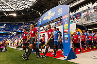 El Salvador and Trinidad and Tobago enter the field for introductions during a CONCACAF Gold Cup group B match at Red Bull Arena in Harrison, NJ, on July 8, 2013.