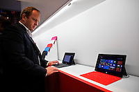 A customer looks at the new Microsoft tablet Surface during the opening of Microsoft's store at Times Square in New York, October 25, 2012. . Photo by Eduardo Munoz Alvarez / VIEW.