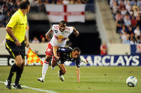 Andros Townsend (31) of Tottenham Hotspur F. C. goes down while marking Jeremy Hall (17) of the New York Red Bulls. Tottenham Hotspur F. C. defeated the New York Red Bulls 2-1 during a Barclays New York Challenge match at Red Bull Arena in Harrison, NJ, on July 22, 2010.