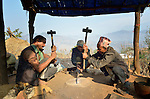 Blacksmiths in Dhawa, a village in the Gorkha District of Nepal, work together fabricating metal knives. In Nepal's caste system, blacksmiths are near the bottom, but helping them recover their livelihoods after a 2015 earthquake ravaged their community has been a priority for some aid agencies.