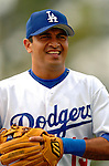19 March 2006: Oscar Robles, infielder for the Los Angeles Dodgers, returns to the dugout during a Spring Training game against the Washington Nationals at Holeman Stadium, in Vero Beach, Florida. The Dodgers defeated the Nationals 9-1 in Grapefruit League play...Mandatory Photo Credit: Ed Wolfstein Photo..