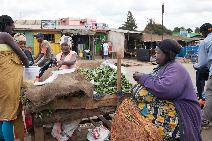 """Mama Safi"" sells vegetables in the street in front of her home in Kawangware slum in Nairobi, Kenya on March 25, 2013. Susan Kalai aka ""Mama Safi"" is a 53 year old Kenyan woman with severe morbid obesity living in Kawangware slum in Nairobi, Kenya. She lives on less than $1 USD a day, selling vegetables and fried potatoes in the street in front of her house. She has 7 children, the youngest one is 9 years old. She suffers from several obesity-related diseases. She can't walk, has a lot of pain in her legs and back and also has difficulties to breathe. She says ""I was born big. I was always like this. Both my parents and my sister are big too. So for me it's normal. Nothing is wrong with me"". She has no knowledge about obesity and she can't go to the doctor to get treated because she has no money to pay for it. She is afraid to die of a heart attack. Although large parts of Africa are plagued with malnutrition, the continent must now also deal with another problem: obesity. Obesity is fast becoming a serious problem in Kenya and even the poorest are now being affected. Obesity rates are climbing around the world and they are rising faster in developing countries than in developed ones. (Photo by Benedicte Desrus)"