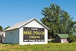 Historic Mail Pouch Tobacco advertisement pained on the end of a white wooden barn, rural Ohio