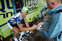 Tour de Suisse Stage 9 - Young Peter Sagan is quickly becoming a favorite among Europeans.  Here, he waved off his coaches objections and allowed several fans behind the team's security perimeter to sign autographs while he was warmed up for the TT.