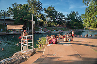 Barton Springs Pool Photo: View with diving board. The diving board at Barton Springs Pool is always a popular activity and is well worth the wait.
