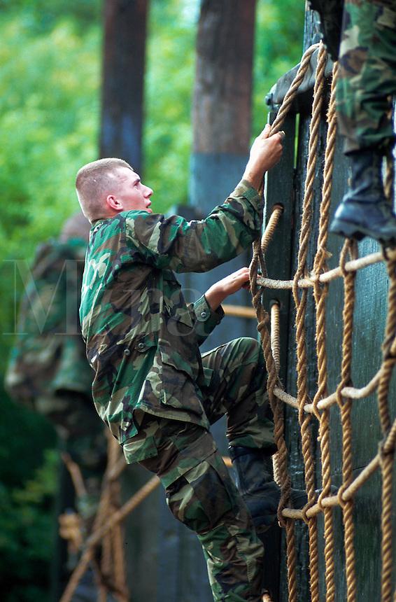 Male female recruits on a training confidence course. San Antonio, Texas.
