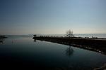 Neuchatel harbour,with empty seats on the promenade, Neuchatel, Switzerland.