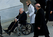 Washington, DC - January 20, 2009 -- United States Vice President Dick Cheney arrives in a wheelchair at the US Capitol for the swearing in of Barack Obama as the 44th US president in Washington, DC, on January 20, 2009. Cheney hurt his back moving boxes. .Credit: Saul Loeb - Pool via CNP
