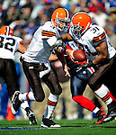 11 October 2009: Cleveland Browns' quarterback Derek Anderson hands off to running back Jamal Lewis during a game against the Buffalo Bills at Ralph Wilson Stadium in Orchard Park, New York. The Browns defeated the Bills 6-3 for Cleveland's first win of the season...Mandatory Photo Credit: Ed Wolfstein Photo