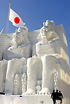 Members of Japan's Ground Self-Defense Force march away after raising the national flag in front of a massive snow sculpture in Sapporo City, northern Japan. About 2 million people visit the city to see the hundreds of hand-crafted snow and ice sculptures that have graced the Sapporo Snow Festival since its inception in 1950.