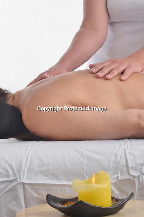 Holistic photo of a woman receiving massage